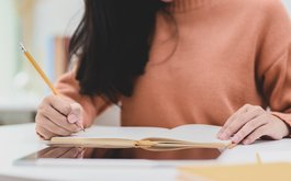 Canva - Photo Of Woman Writing On Notebook.jpg